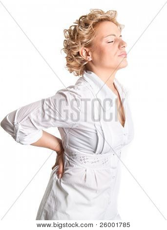 Hurting back pain. Young woman holds her back in pain.