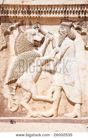 Persian soldier bas-relief killing a bist, stone statue in Shiraz, Iran.