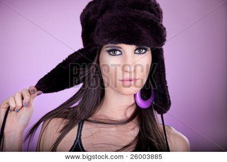 Beautiful young woman with black cap, studio shot