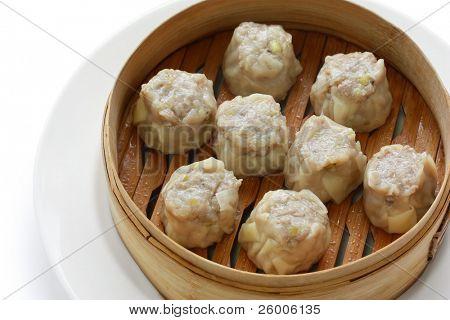 Shumai dumplings in a bamboo basket