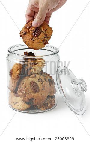 De la mano en el tarro de galletas