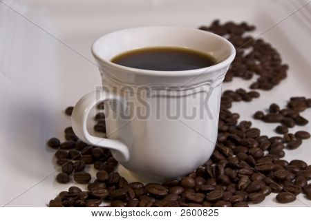 Black Coffee In White Cup With Whole Beans