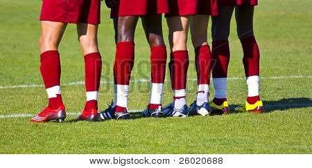 Soccer players waiting the ball