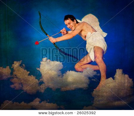 Flying Cupid on vintage postcard
