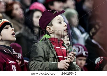 CLUJ-NAPOCA, ROMANIA - FEBRUARY 28: Child watches a game at a Romanian National Championship soccer game CFR Cluj vs. Steaua Bucuresti, February 28, 2010 in Cluj-Napoca, Romania.