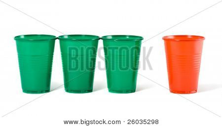 Multi-coloured disposable plastic glasses isolated on white background