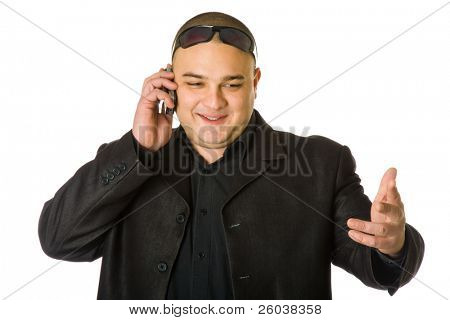 Man in black suit in sun glasses talking on the mobile phone. Isolated on white background