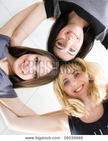 Three young girls. Isolated on white background