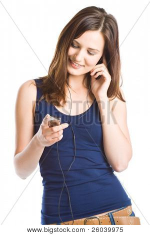 Young woman listening to music on mp3 player. Isolated on white background