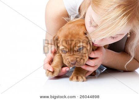 Young girl with puppy of Dogue de Bordeaux (French mastiff). Isolated on white background