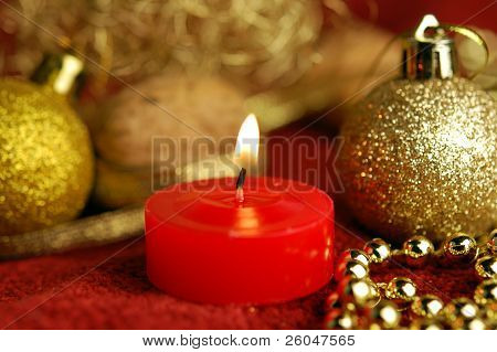 Candle And Christmas Ornaments