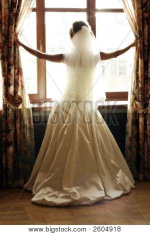 Bride Beside Window