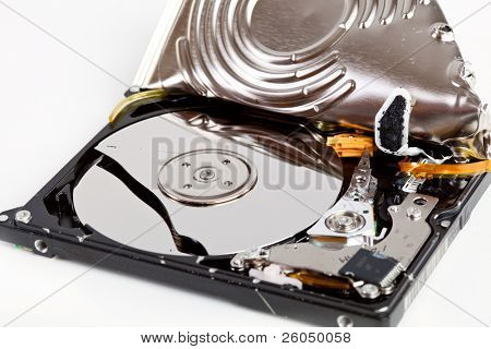 Broken hard disk drive on gray background