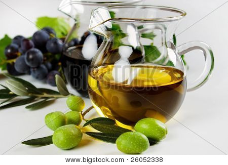 Extra virgin olive oil and balsamic vinegar on white background