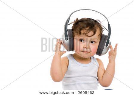 Baby With Headphones.