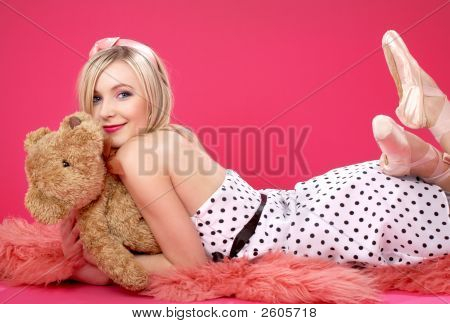 Lovely Blond With Teddy Bear Over Pink