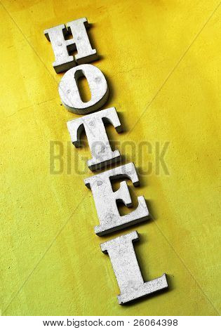 hotel sign on old yellow wall