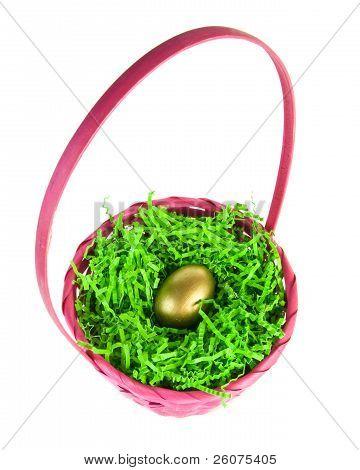 Golden Egg Nestled In A Pink Easter Basket