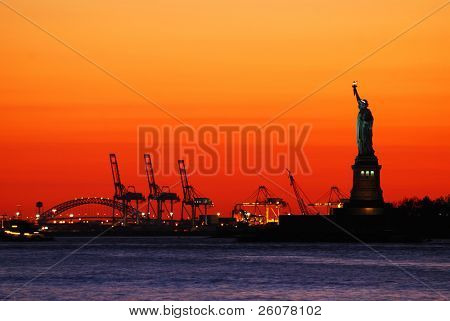New York City Manhattan Statue of Liberty silhouette at sunset.
