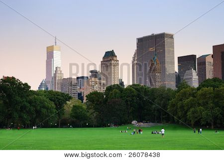 New York City Central Park at dusk panorama with Manhattan skyline and skyscrapers.