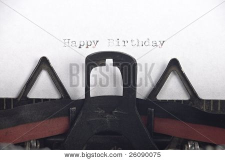 Vintage typewriter with happy birthday written and room for your text