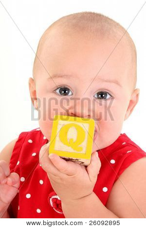 Beautiful 10 Month Old Baby Girl With Toy Block