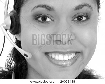 Beautiful Receptionist Wearing Headset in Black and White. Shot in studio over white.