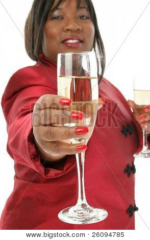 Beautiful African American woman offering a glass of champange.
