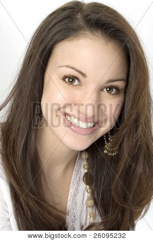 Beautiful seventeen year old girl.  Great smile and bright eyes.  Shot in studio.