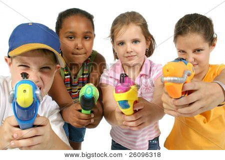 Group of friends aiming water guns at camera.