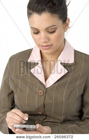Beautiful young Hispanic business woman writing in PDA.