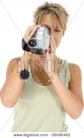 Woman with video camera aimed at camera.