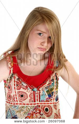 Beautiful 14 year old teen with hands on hips making pouting face.