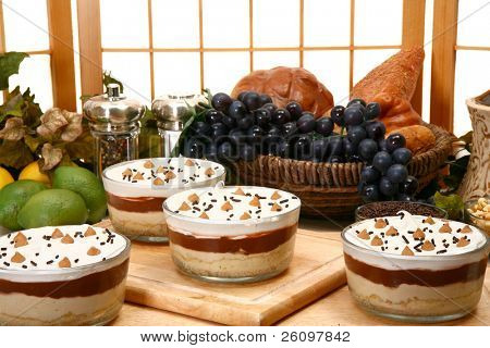 Layered peanut butter pudding with peanut butter mouse, chocolate pudding, vanilla pudding, whipped topping on a pie crust.