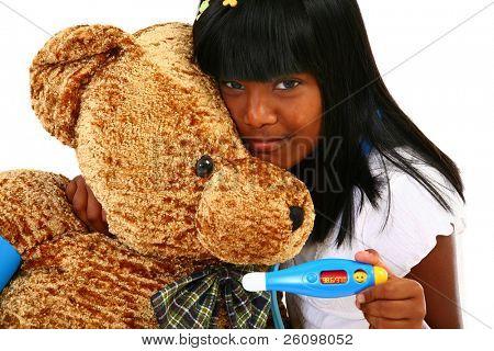 Beautiful Indian girl playing nurse to giant teddy bear.