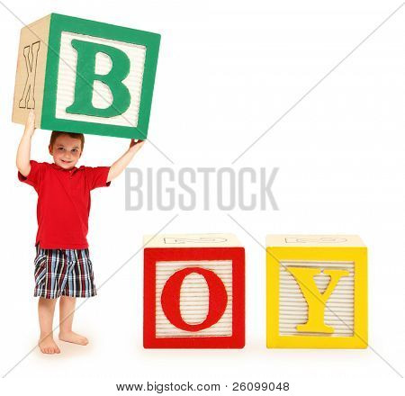 Colorful alphabet blocks spelling the word boy with letter b held by adorable three year old boy.