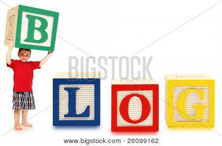 Colorful alphabet blocks spelling the word BLOG with adorable three year old boy.