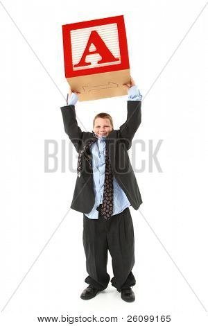 Handsome ten year old boy in over sized suilt holding giant letter A block above head.