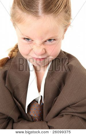 Adorable five year old american making angry expression wearing baggy suit.