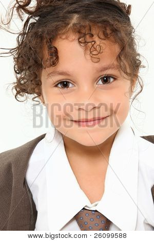 Beautiful three year old mixed race girl in baggy men's suit close up over white.
