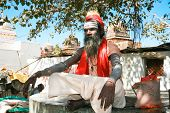 ORCHHA, INDIA -17 FEBRUARY: Spiritual Guru Shaiva sadhu (holy man) sits under the tree in front of