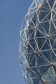 stock photo of geodesic  - A detail of a geodesic dome invented by Richard Buckminster Fuller against a blue sky - JPG
