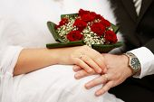 stock photo of married couple  - Detail of hands of wedding couple with wedding bouquet - JPG