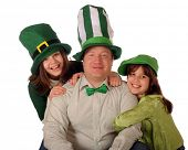 image of st patrick  - A family portrait of a dad and his two daughters celebrating St - JPG