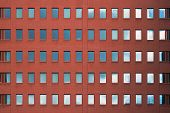 Old Red Brick Wall With Windows. Facade Of Office Building With Windows. Facade Of An Old Red Brick  poster