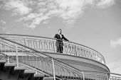 Confident Businessman Stand On Balcony On Cloudy Blue Sky. Man In Formal Wear Outdoor. Looking To Th poster