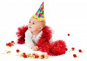 image of new years baby  - a baby is sitting on a floor with christmas decoration - JPG