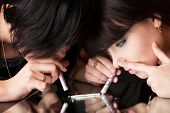 stock photo of crack cocaine  - girls are sniffing cocaine  - JPG