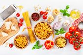 ingredients for italian cousine flat lay, pasta spaghetti penne fusilli tomato oil vegetables poster