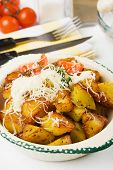 Spicy roasted potato with cream and grated parmesan cheese poster